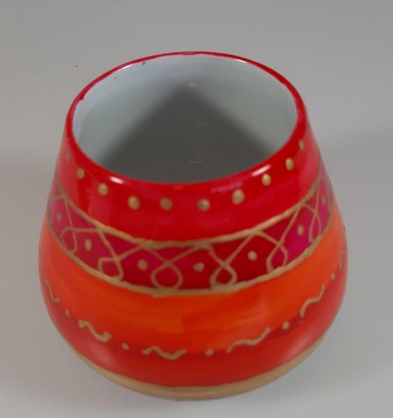 Vase mit weihnachtlichen Farben